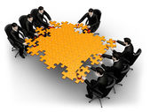 Business team building a puzzle — Stock Photo