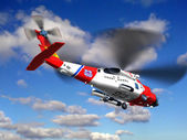 Helicopter coast guard fly in clouds — Stock Photo