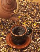 Kettle with tea — Stock Photo