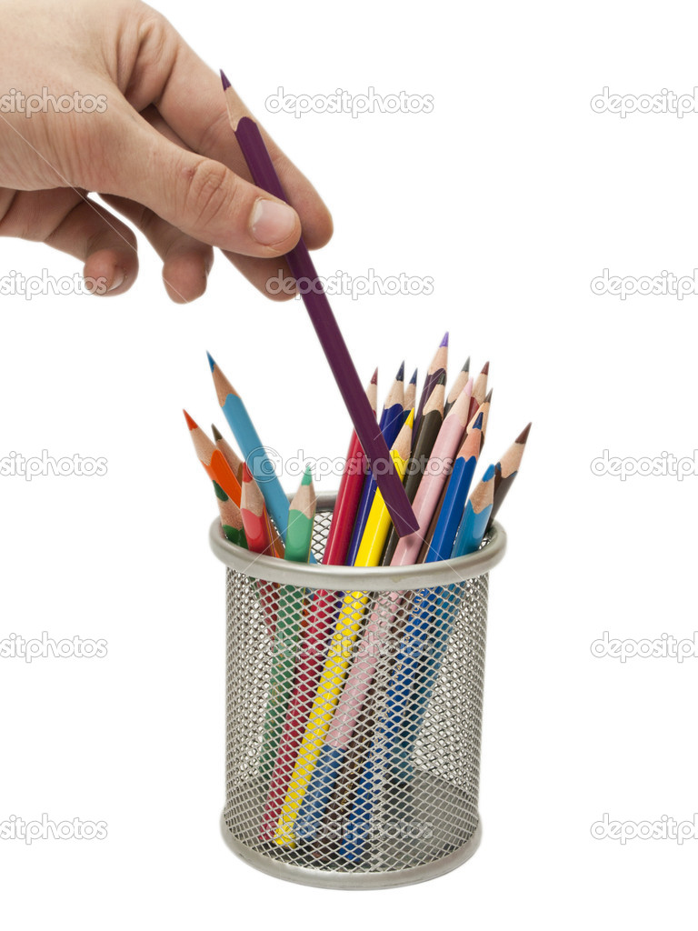 Hand with the colored pencil on a white background — Stock Photo #5042739