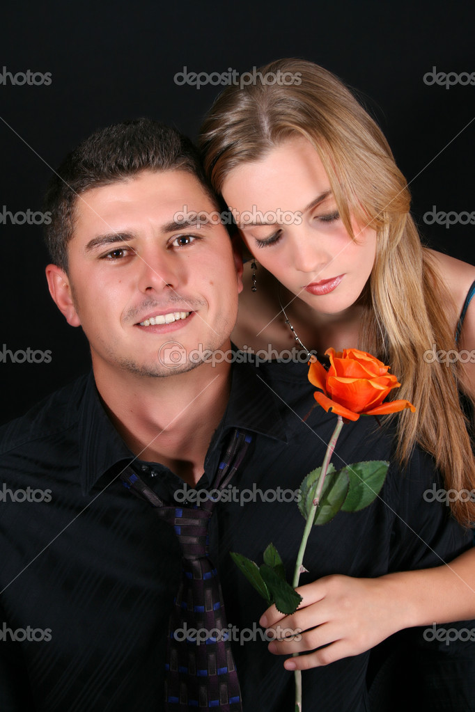 Young couple in love, faces close to one another — Stock Photo #5041959