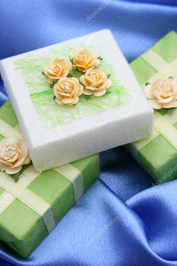 Soap gifts wrapped in green paper decorated with roses  Stock Photo #5042740