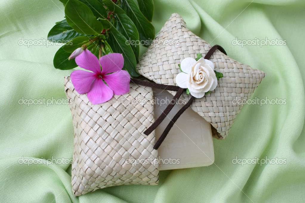 Soap gift in a woven bag with fresh flowers — Stock Photo #5042818