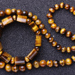 Bracelet and a necklace of tiger eye . — Stockfoto