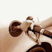 A woman's hand taking gas — Stock Photo