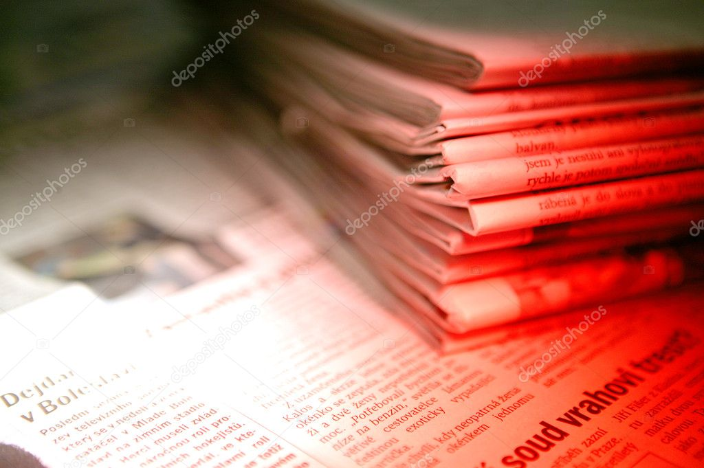 A detail of a pile of newspaper in red light — Stock Photo #4979855