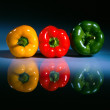 Three colored pepers on a table 2 — Stock Photo