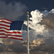 USA flag dark sky and clouds — Stock Photo