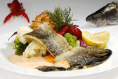 Grilled trout w cream sauce — Stock Photo