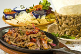 Hot pan with meat mexican style — Stock Photo