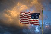 USA flag dark sky and clouds — Stock Photo
