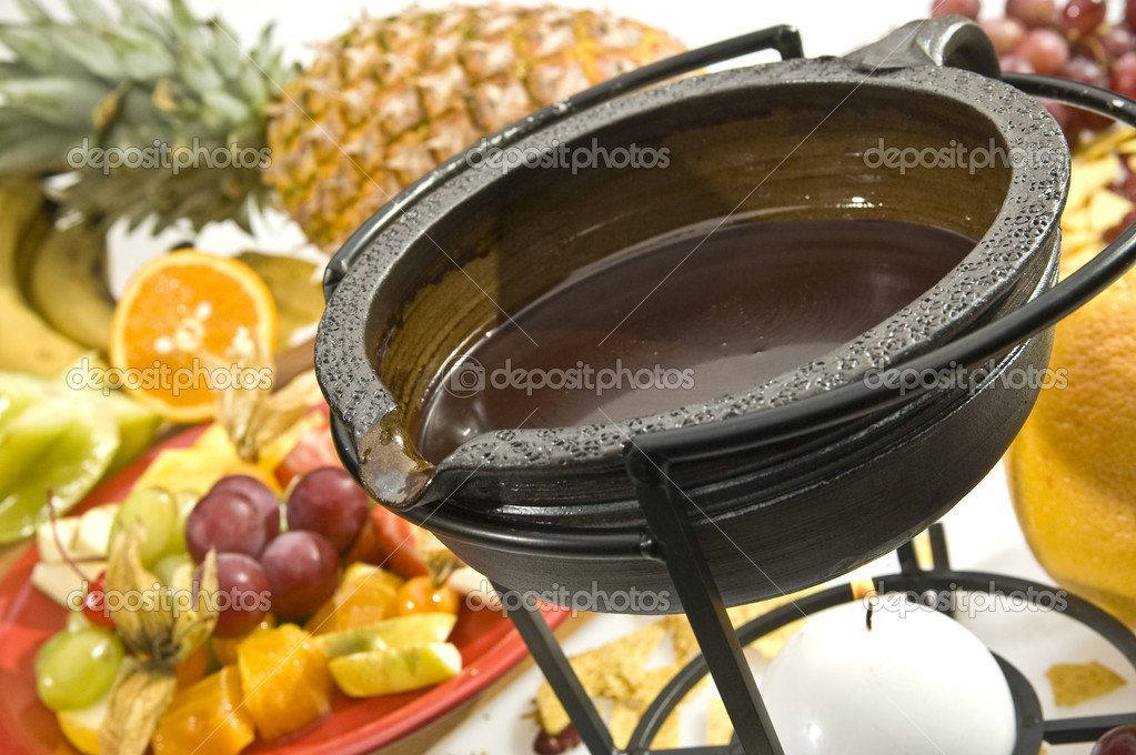 Chocolate fondue with various kind of fruit — Stock Photo #4983371