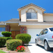 New American dream home with brand new car — Stock Photo