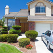 New American dream home with brand new car — Stock Photo #4986042