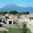 Pompei ruins in italy with Mount Vesuvius - Stock Photo
