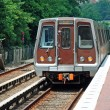Metro unit leaves station - Stock Photo