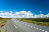 Empty road with a beautiful blue sky in horizon — Stock Photo