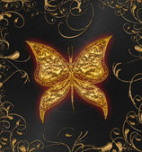 Gold butterfly on the black — Stock Photo