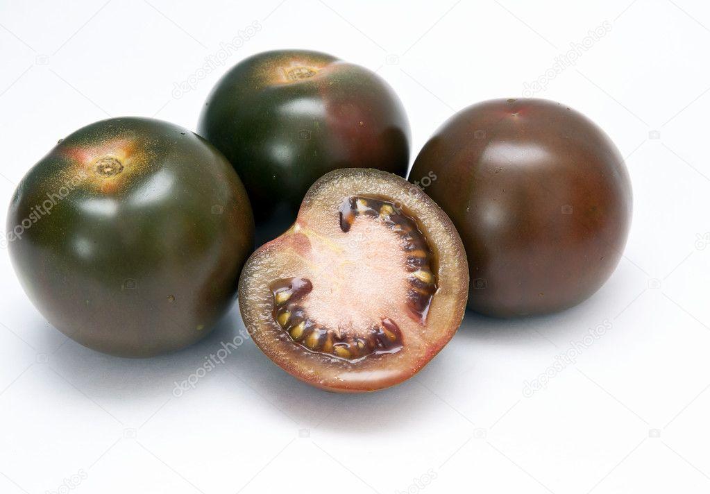 Black tomato Kumato. — Stock Photo © elemak #5014067