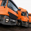 Three orange trucks — Stock Photo #4974648