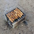 Stock Photo: Barbeque on sand