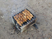 Barbeque on a sand — Stock Photo
