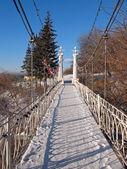 Little bridge under slope in the park. — Stock Photo