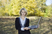 Economy on rent of office in crisis period. Workplace in the autumn forest. — Stock Photo