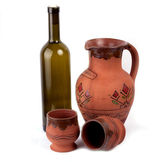Wine bottle, clay pot and cup — Stock Photo