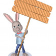 Rabbit holds a wooden signboard — Stock Photo