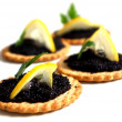 Caviar lemon and biscuit - Stock Photo