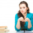 Stock Photo: Girl with pen and books