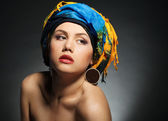 A young woman dressed in a turban — Stock Photo