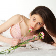 Girl with flover in the bed — Stock Photo #5359002