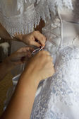 To the bride fasten a wedding dress — Stock Photo