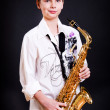 Stock Photo: 9 year old boy with saxophone