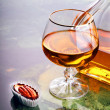 Snifter of cognac — Stock Photo