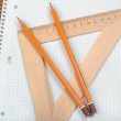 Stock Photo: Notebook with pencils and triangle