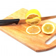Lemon and knife on hardboard — Stock Photo
