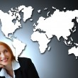 Positive businesswoman and map of the world. — Stock Photo