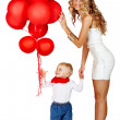 Woman and little boy with red balloons - Stock Photo