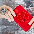 Red gift box in woman's hands. - Stock Photo