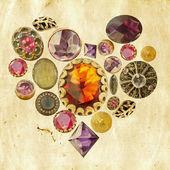 Precious stones heart on grunge background — Stock Photo
