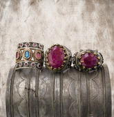 Three ottoman rings on grunge background. — Stock Photo