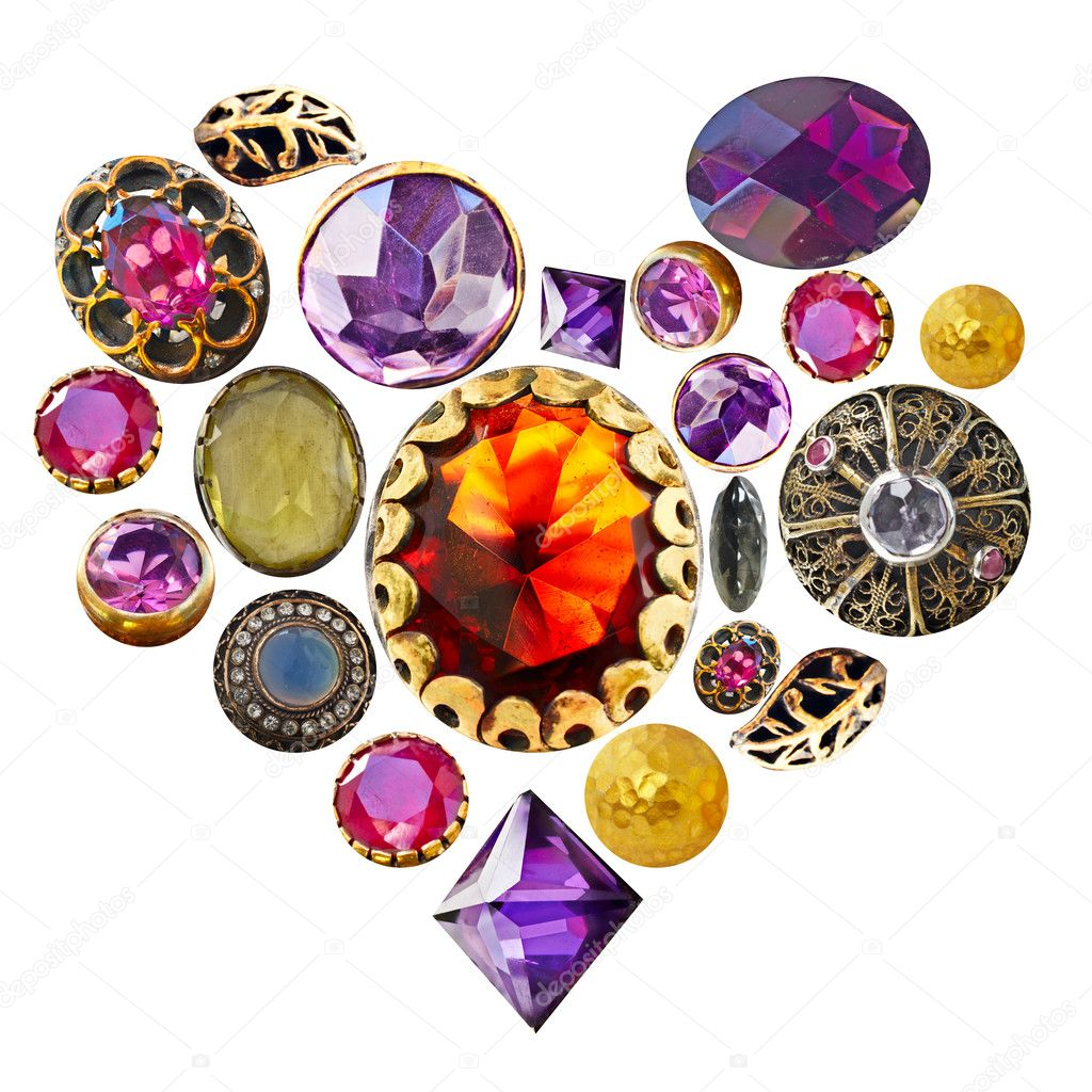 Gemstones in gold and bronze isolated in a heart shape on white background.  Stock Photo #5289317