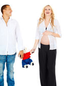 Pregnant couple with toy bear — Stock Photo