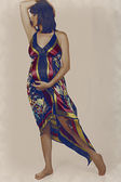 Pregnant woman in long dress — Stock Photo