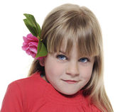 Child with camelia flowers — Stock Photo