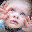 Child behind the glass. — Stock Photo