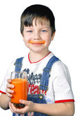 The boy has control over a glass of carrot juice — Stock Photo